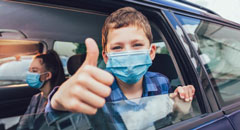 Child wearing mask in car