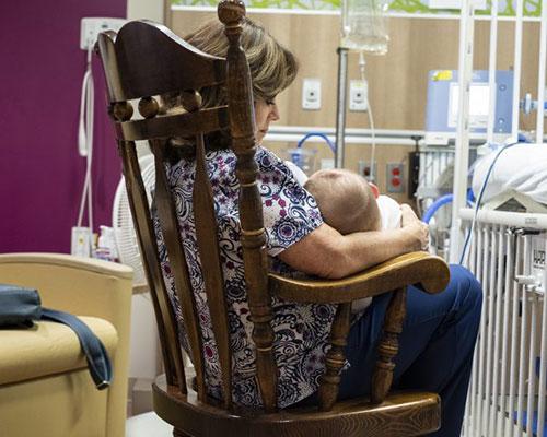 NICU nurse with patient